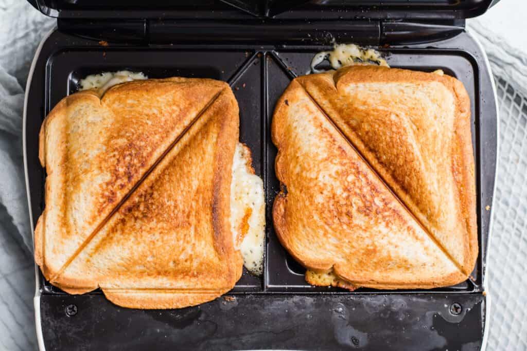 cooked sandwich in a sandwich maker