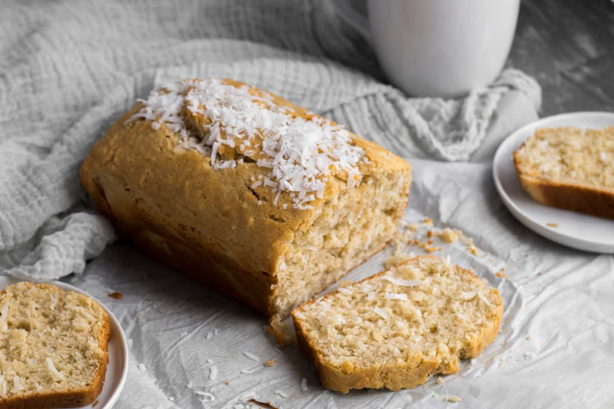 coconut bread with a slice of bread on a plate