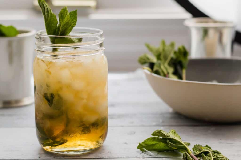 mason jar mint julep with mint garnish