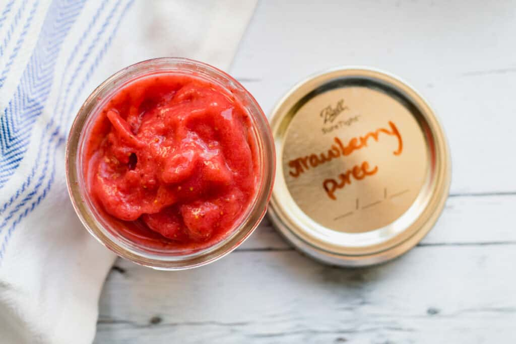 strawberry puree in a mason jar with labeled lid