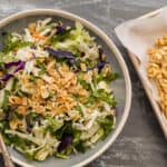 asian cabbage crunch salad with crunchy topping next to it